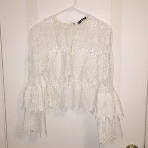 Long sleeved white lace shirt